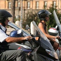 moto Riding a Scooter in Rome