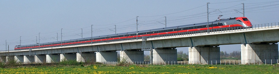 115 Header -AV Train traveling over Bridge